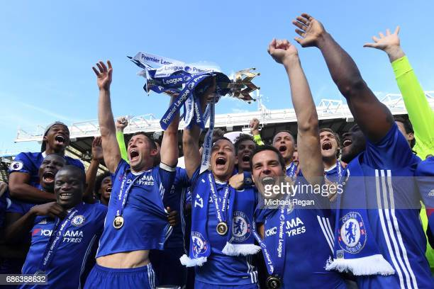 Gary Cahill of Chelsea and John Terry of Chelsea lift the Premier Leauge Trophy after the Premier League match between Chelsea and Sunderland at...