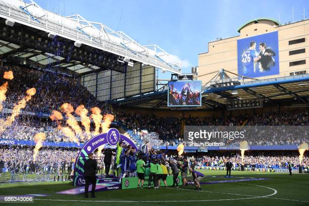Gary Cahill of Chelsea and John Terry of Chelsea lifts the Premier Leauge Trophy after the Premier League match between Chelsea and Sunderland at...