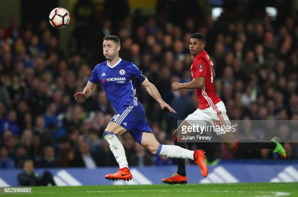 Gary Cahill of Chelsea and Marcus Rashford of Manchester United chase the ball during The Emirates FA Cup QuarterFinal match between Chelsea and...