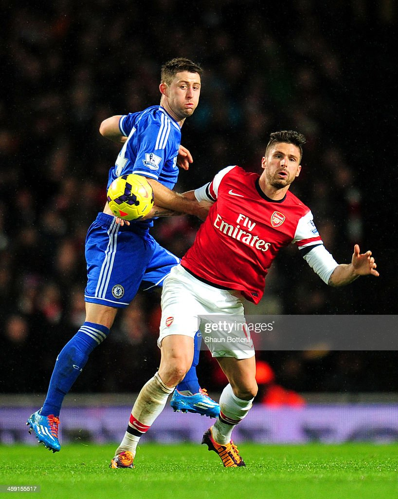 Gary Cahill of Chelsea and Olivier Giroud of Arsenal compete for the ball during the Barclays Premier League match between Arsenal and Chelsea at Emirates Stadium on December 23, 2013 in London, England.