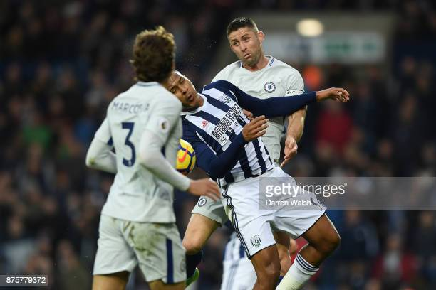 Gary Cahill of Chelsea battles with Jose Salomon Rondon of West Bromwich Albion during the Premier League match between West Bromwich Albion and...