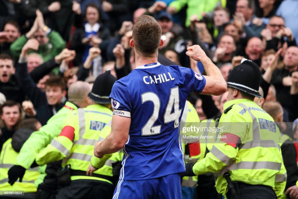 Gary Cahill of Chelsea celebrates after scoring a goal to make it 1-2 during the Premier League match between Stoke City and Chelsea at Bet365 Stadium on March 18, 2017 in Stoke on Trent, England.