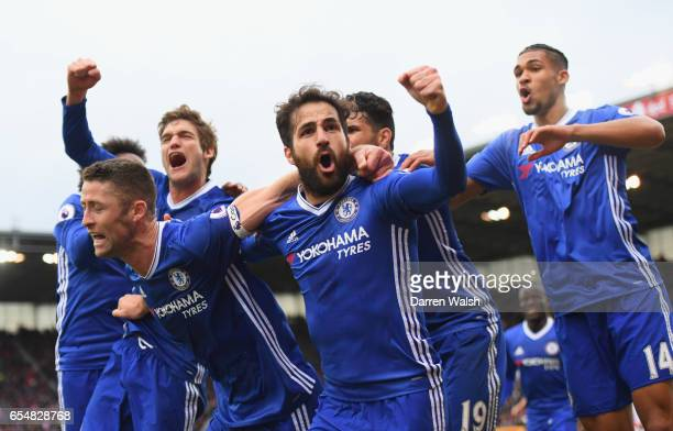 Gary Cahill of Chelsea celebrates as he scores their second goal with Cesc Fabregas and team mates during the Premier League match between Stoke City...