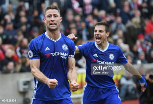 Gary Cahill of Chelsea celebrates as he scores their second goal with Cesar Azpilicueta during the Premier League match between Stoke City and...