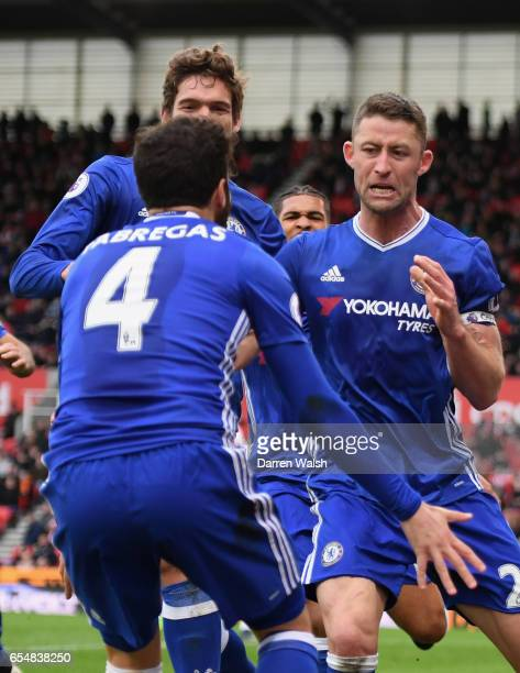 Gary Cahill of Chelsea celebrates as he scores their second goal with Marcos Alonso and Cesc Fabregas during the Premier League match between Stoke...