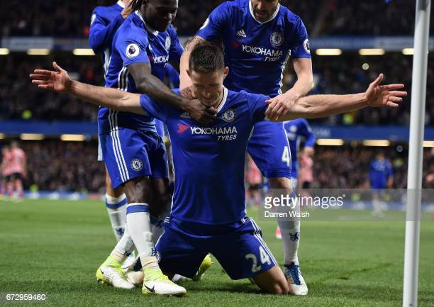 Gary Cahill of Chelsea celebrates as he scores their second goal with team mates during the Premier League match between Chelsea and Southampton at...