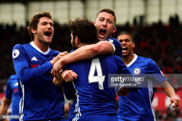 Gary Cahill of Chelsea celebrates scoring his side's second goal during the Premier League match between Stoke City and Chelsea at Bet365 Stadium on...