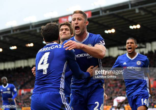 Gary Cahill of Chelsea celebrates scoring his sides second goal with Cesc Fabregas of Chelsea during the Premier League match between Stoke City and...