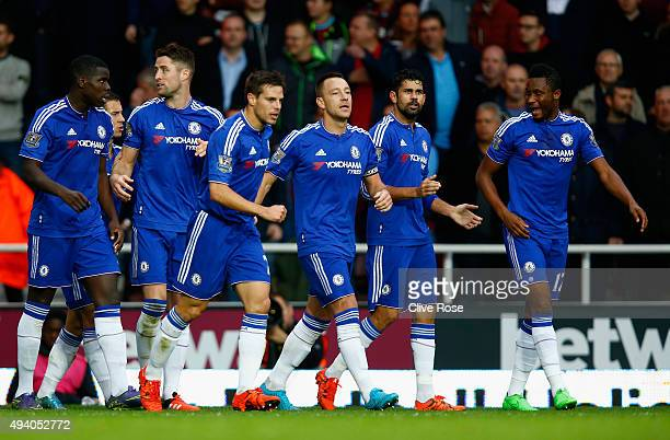 Gary Cahill of Chelsea celebrates scoring his team's first goal with his team mates during the Barclays Premier League match between West Ham United...