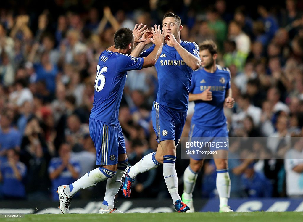 <a gi-track='captionPersonalityLinkClicked' href=/galleries/search?phrase=Gary+Cahill&family=editorial&specificpeople=204341 ng-click='$event.stopPropagation()'>Gary Cahill</a> of Chelsea celebrates scoring their second goal with <a gi-track='captionPersonalityLinkClicked' href=/galleries/search?phrase=John+Terry&family=editorial&specificpeople=171535 ng-click='$event.stopPropagation()'>John Terry</a> of Chelsea during the Barclays Premier League match between Chelsea and Reading at Stamford Bridge on August 22, 2012 in London, England.