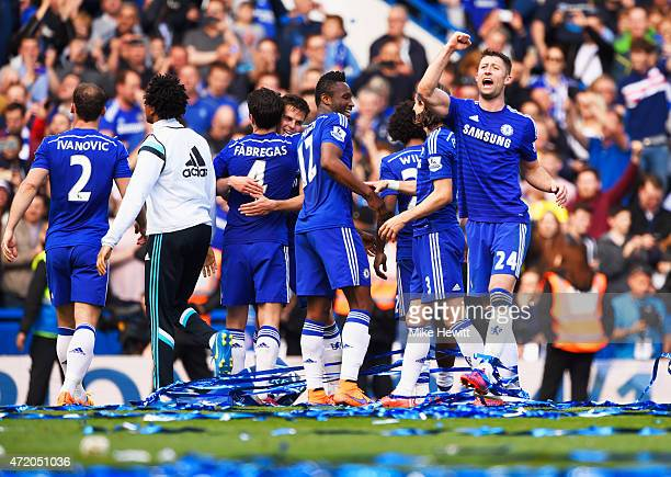 Gary Cahill of Chelsea celebrates winning the Premier League title with team mates after the Barclays Premier League match between Chelsea and...
