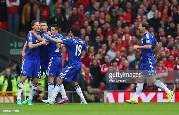Gary Cahill of Chelsea celebrates with team mates after scoring their first goal during the Barclays Premier League match between Liverpool and...