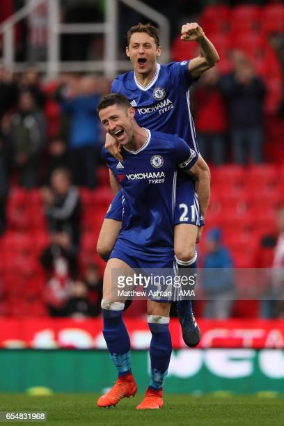 Gary Cahill of Chelsea celebrates with teammate Nemanja Matic at the end of the Premier League match between Stoke City and Chelsea at Bet365 Stadium...