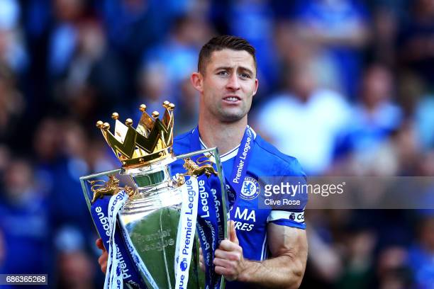 Gary Cahill of Chelsea celebrates with the Premier League Trophy after the Premier League match between Chelsea and Sunderland at Stamford Bridge on...