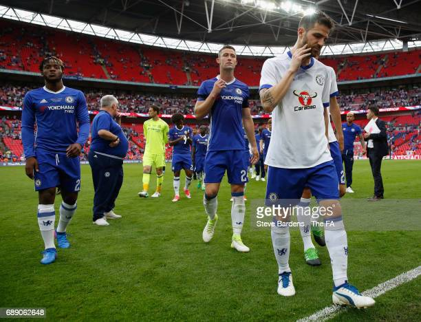 Gary Cahill of Chelsea Cesc Fabregas of Chelsea and Michy Batshuayi of Chelsea look dejected after the Emirates FA Cup Final between Arsenal and...
