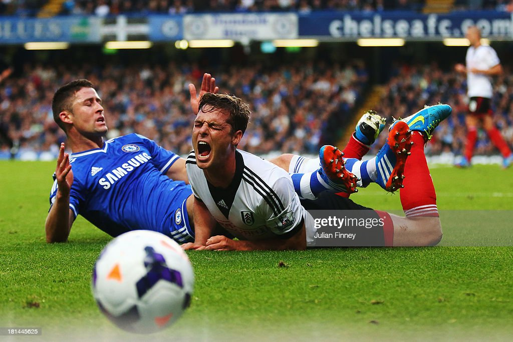 <a gi-track='captionPersonalityLinkClicked' href=/galleries/search?phrase=Gary+Cahill&family=editorial&specificpeople=204341 ng-click='$event.stopPropagation()'>Gary Cahill</a> (L) of Chelsea challenges Scott Parker (R) of Fulham during the Barclays Premier League match between Chelsea and Fulham at Stamford Bridge on September 21, 2013 in London, England.