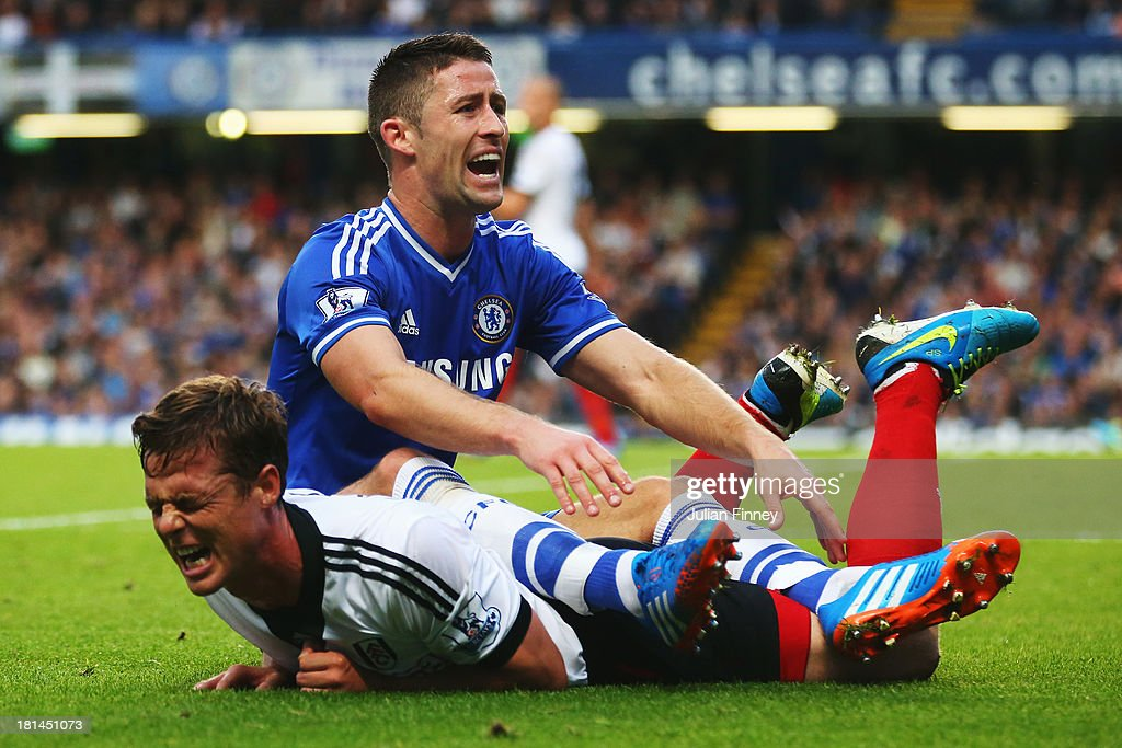 <a gi-track='captionPersonalityLinkClicked' href=/galleries/search?phrase=Gary+Cahill&family=editorial&specificpeople=204341 ng-click='$event.stopPropagation()'>Gary Cahill</a> (top) of Chelsea challenges Scott Parker (bottom) of Fulham during the Barclays Premier League match between Chelsea and Fulham at Stamford Bridge on September 21, 2013 in London, England.