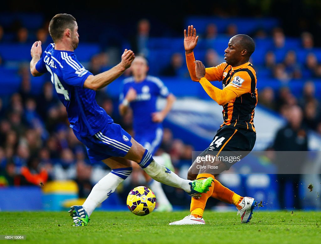 Gary Cahill of Chelsea challenges Sone Aluko of Hull City during the Barclays Premier League match between Chelsea and Hull City at Stamford Bridge on December 13, 2014 in London, England.