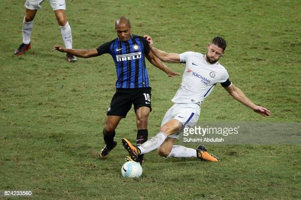 Gary Cahill of Chelsea FC and Joao Mario of FC Internazionale challenge for the ball during the International Champions Cup match between FC...