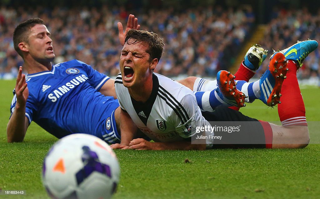 <a gi-track='captionPersonalityLinkClicked' href=/galleries/search?phrase=Gary+Cahill&family=editorial&specificpeople=204341 ng-click='$event.stopPropagation()'>Gary Cahill</a> of Chelsea fouls Scott Parker of Fulham during the Barclays Premier League match between Chelsea and Fulham at Stamford Bridge on September 21, 2013 in London, England.
