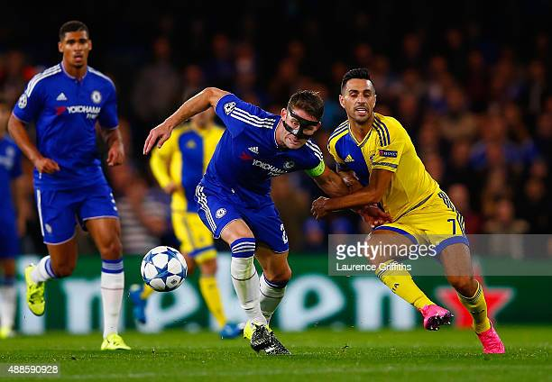 Gary Cahill of Chelsea holds off Eran Zahavi of Maccabi Tel Aviv during the UEFA Chanmpions League group G match between Chelsea and Maccabi TelAviv...