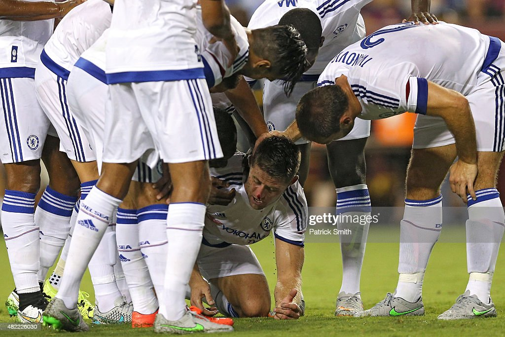 <a gi-track='captionPersonalityLinkClicked' href=/galleries/search?phrase=Gary+Cahill&family=editorial&specificpeople=204341 ng-click='$event.stopPropagation()'>Gary Cahill</a> #24 of Chelsea is congratulated by teammates after scoring a goal against Barcelona in the second half during the International Champions Cup North America at FedExField on July 28, 2015 in Landover, Maryland. Chelsea won in a penalty shootout.