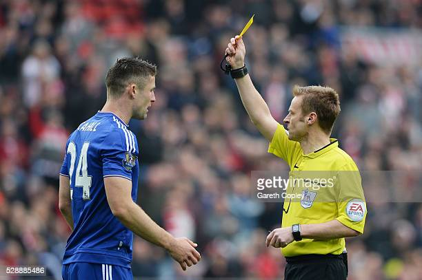 Gary Cahill of Chelsea is shown a yellow card by referee Mike Jones during the Barclays Premier League match between Sunderland and Chelsea at the...