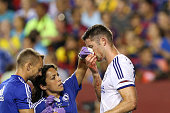 Gary Cahill of Chelsea is tended to by medical staff after scoring a goal against Barcelona in the second half during the International Champions Cup...