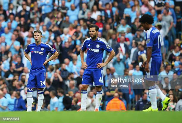 Gary Cahill of Chelsea looks dejected with team mates after the third Manchester City goal scored by Fernandinho of Manchester City during the...