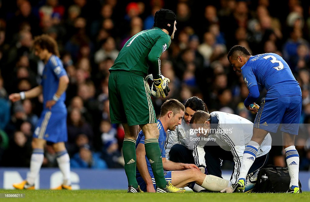 Gary Cahill of Chelsea receives treatment during the Barclays Premier League match between Chelsea and West Ham United at Stamford Bridge on March 17, 2013 in London, England.