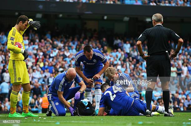 Gary Cahill of Chelsea receives treatment from the new Chelsea medical team during the Barclays Premier League match between Manchester City and...