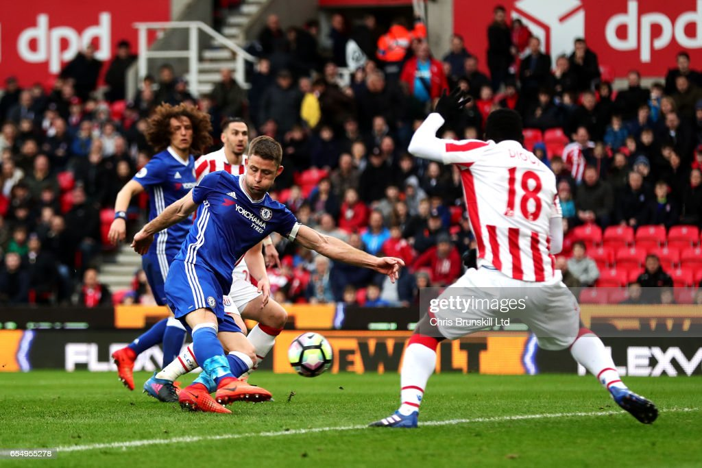Gary Cahill of Chelsea scores his side's second goal during the Premier League match between Stoke City and Chelsea at Bet365 Stadium on March 18, 2017 in Stoke on Trent, England.