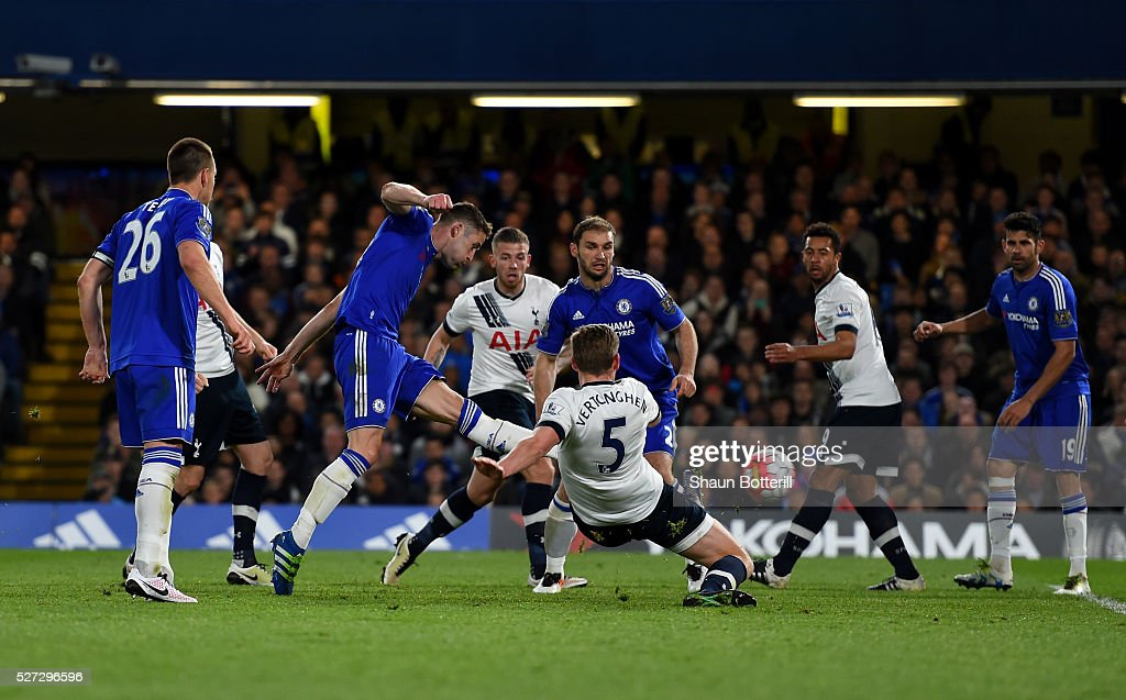<a gi-track='captionPersonalityLinkClicked' href=/galleries/search?phrase=Gary+Cahill&family=editorial&specificpeople=204341 ng-click='$event.stopPropagation()'>Gary Cahill</a> of Chelsea scores his team's first goal during the Barclays Premier League match between Chelsea and Tottenham Hotspur at Stamford Bridge on May 02, 2016 in London, England.jd