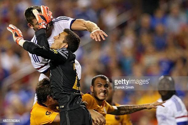 Gary Cahill of Chelsea scores on a header as he is hit in the face by goalkeeper Jordi Masip of Barcelona in the second half during the International...