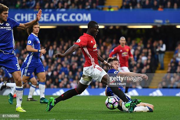 Gary Cahill of Chelsea tackles Eric Bailly of Manchester United during the Premier League match between Chelsea and Manchester United at Stamford...