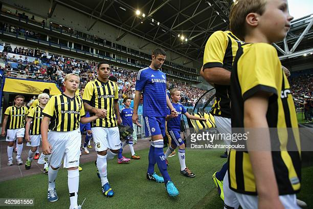 Gary Cahill of Chelsea walks out to play the pre season friendly match between Vitesse Arnhem and Chelsea at the Gelredome Stadium on July 30 2014 in...