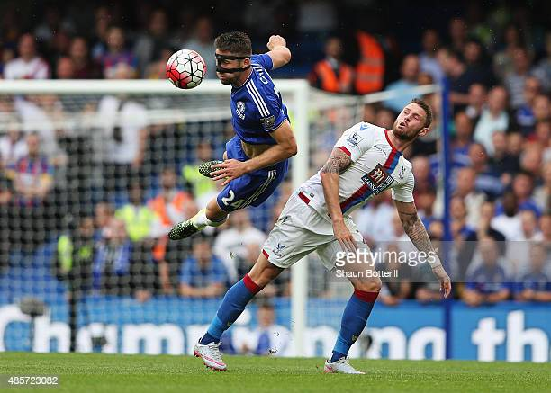 Gary Cahill of Chelsea wins a header ahead of Connor Wickham of Crystal Palace during the Barclays Premier League match between Chelsea and Crystal...