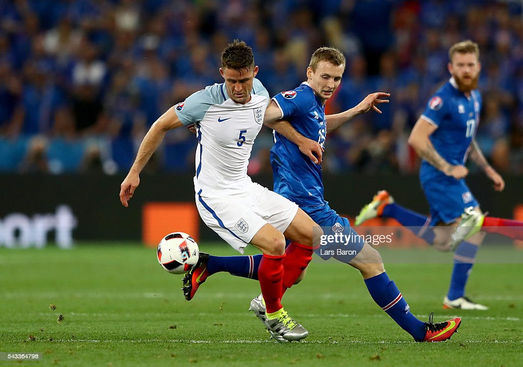 <a gi-track='captionPersonalityLinkClicked' href=/galleries/search?phrase=Gary+Cahill&family=editorial&specificpeople=204341 ng-click='$event.stopPropagation()'>Gary Cahill</a> of England and Jon Dadi Bodvarsson of Iceland compete for the ball during the UEFA EURO 2016 round of 16 match between England and Iceland at Allianz Riviera Stadium on June 27, 2016 in Nice, France.