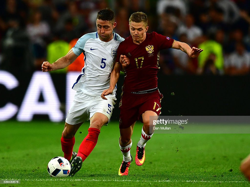 <a gi-track='captionPersonalityLinkClicked' href=/galleries/search?phrase=Gary+Cahill&family=editorial&specificpeople=204341 ng-click='$event.stopPropagation()'>Gary Cahill</a> of England and <a gi-track='captionPersonalityLinkClicked' href=/galleries/search?phrase=Oleg+Shatov&family=editorial&specificpeople=9633751 ng-click='$event.stopPropagation()'>Oleg Shatov</a> of Russia compete for the ball during the UEFA EURO 2016 Group B match between England and Russia at Stade Velodrome on June 11, 2016 in Marseille, France.