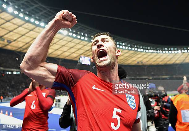 Gary Cahill of England celebrates his team's 32 win after the International Friendly match between Germany and England at Olympiastadion on March 26...