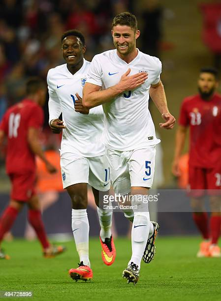 Gary Cahill of England celebrates scoring their second goal with Danny Welbeck of England during the international friendly match between England and...