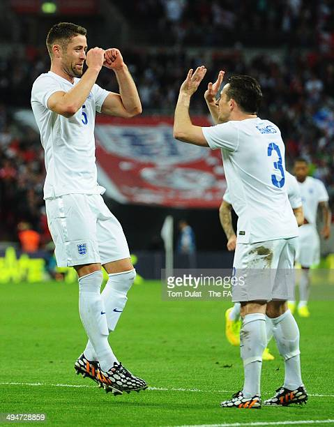 Gary Cahill of England celebrates with Leighton Baines as he scores their second goal with a header during the International Friendly match between...