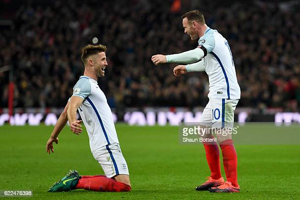 Gary Cahill of England celebrates with Wayne Rooney after scoring their third goal during the FIFA 2018 World Cup qualifying match between England...