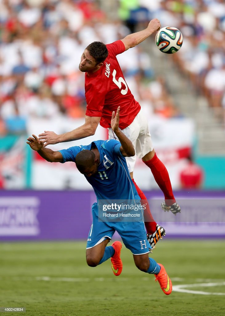 Gary Cahill of England challenges Jerry Bengtson of Honduras during the International Friendly match between England and Honduras at the Sun Life Stadium on June 7, 2014 in Miami Gardens, Florida.