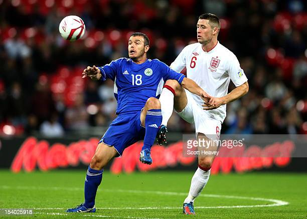Gary Cahill of England competes for the ball with Andy Selva of San Marino during the FIFA 2014 World Cup Group H qualifying match between England...