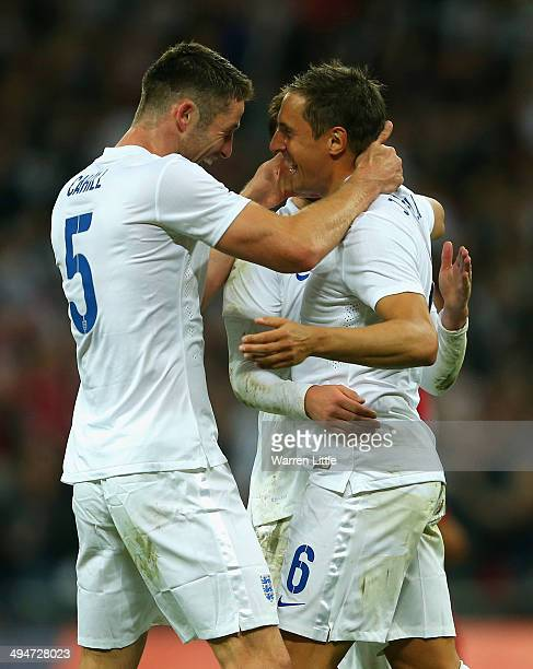 Gary Cahill of England congratulates Phil Jagielka of England on scoring their third goal during the international friendly match between England and...