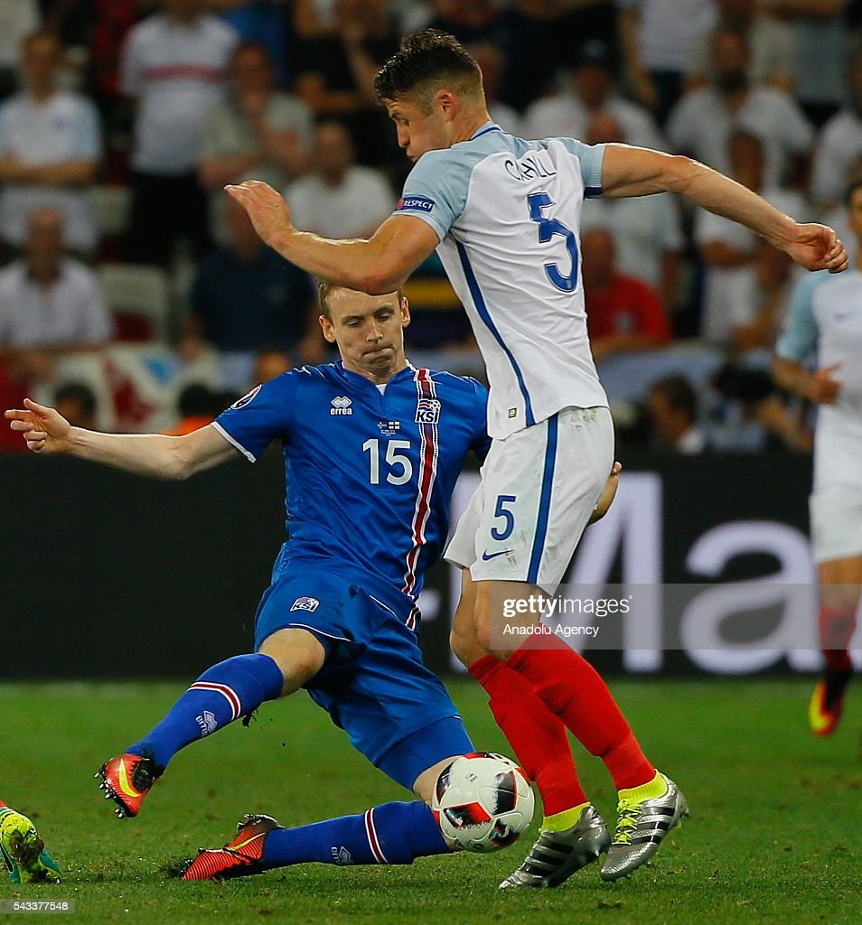 Gary Cahill (5) of England in action against Jon Dadi Bödvarsson (15) of Iceland during the UEFA Euro 2016 Round of 16 football match between Iceland and England at Stade de Nice in Nice, France on June 27, 2016.