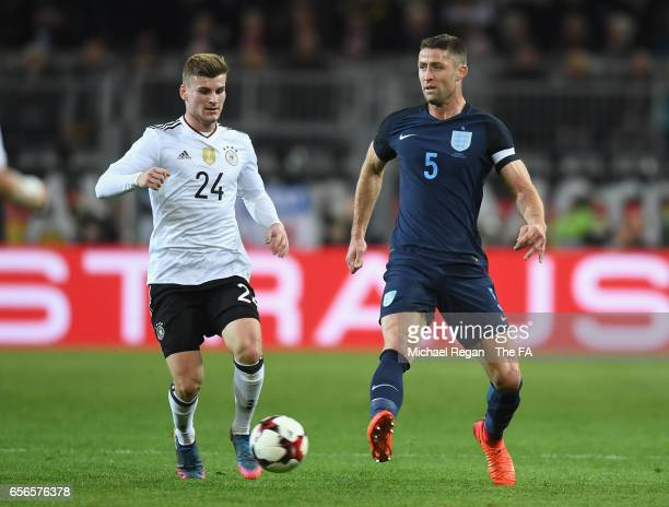Gary Cahill of England is put under pressure from Timo Werner of Germany during the international friendly match between Germany and England at...
