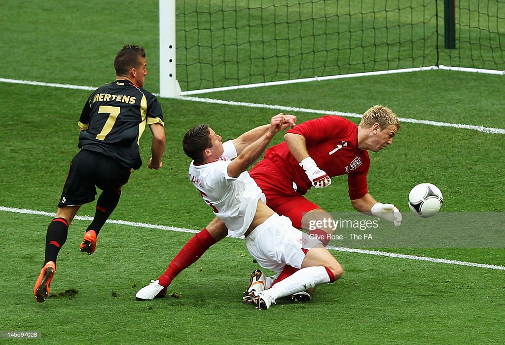 <a gi-track='captionPersonalityLinkClicked' href=/galleries/search?phrase=Gary+Cahill&family=editorial&specificpeople=204341 ng-click='$event.stopPropagation()'>Gary Cahill</a> of England runs into team mate <a gi-track='captionPersonalityLinkClicked' href=/galleries/search?phrase=Joe+Hart&family=editorial&specificpeople=1295472 ng-click='$event.stopPropagation()'>Joe Hart</a> and comes off injured during the International Friendly match between England and Belgium at Wembley Stadium on June 2, 2012 in London, England.