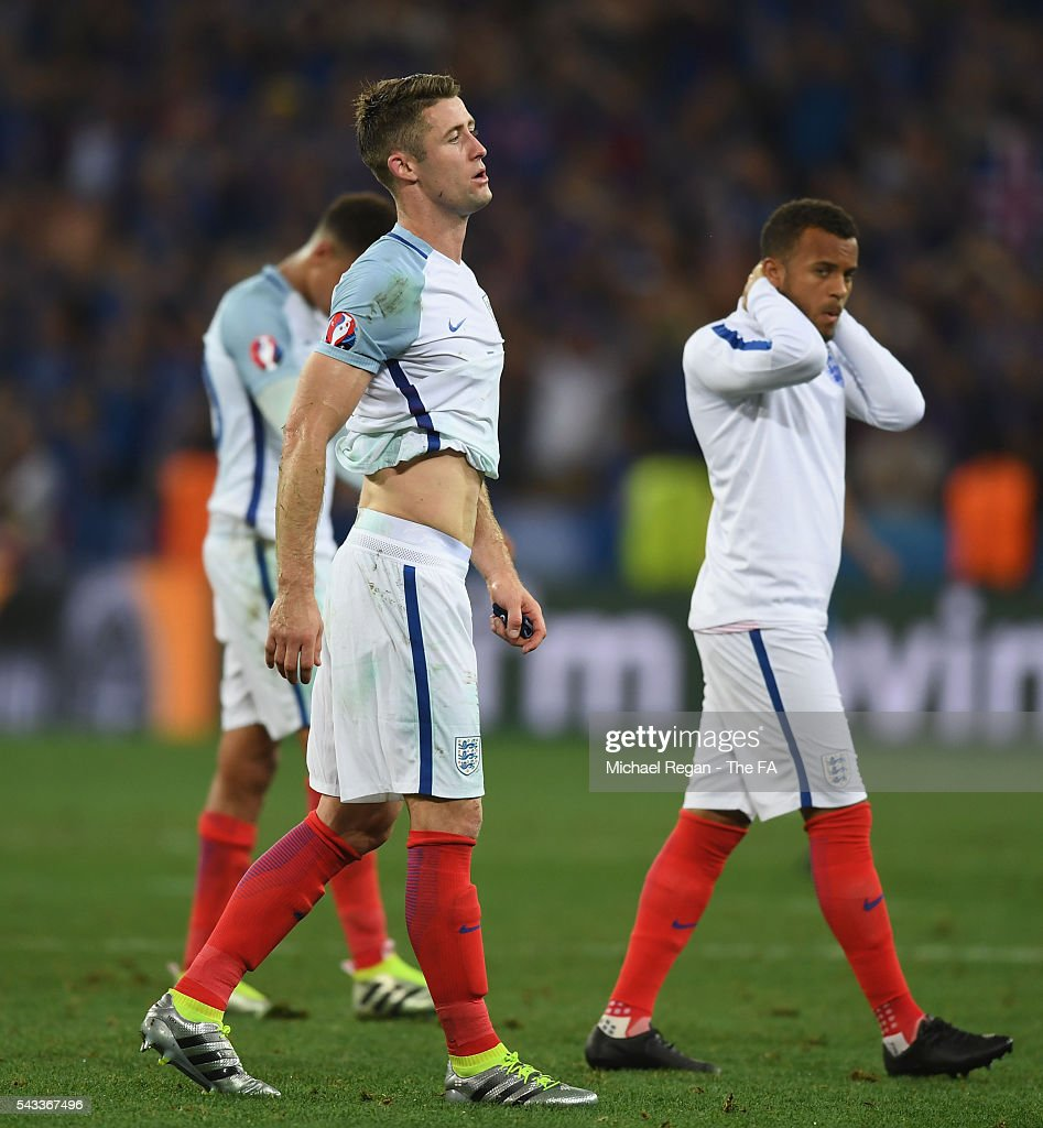 <a gi-track='captionPersonalityLinkClicked' href=/galleries/search?phrase=Gary+Cahill&family=editorial&specificpeople=204341 ng-click='$event.stopPropagation()'>Gary Cahill</a> (L) of England shows his dejection after his team's 1-2 defeat in the UEFA EURO 2016 round of 16 match between England and Iceland at Allianz Riviera Stadium on June 27, 2016 in Nice, France.